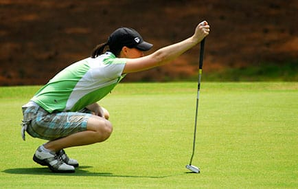 business professional on her luxury group travel golfing trip