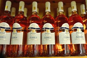 bottles of dry rose wine in local shop in village Bonneux, Provence, France. Provence region of France have rich wine culture and wine lovers offers a wide variety of flavors