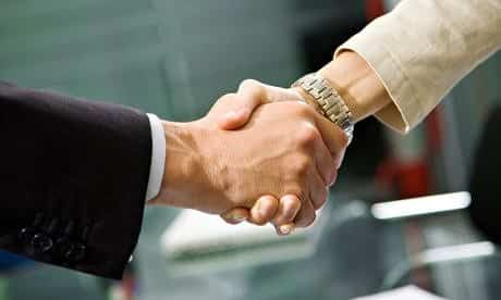 two people shaking their hands, closing a luxury travel deal with a luxury travel company
