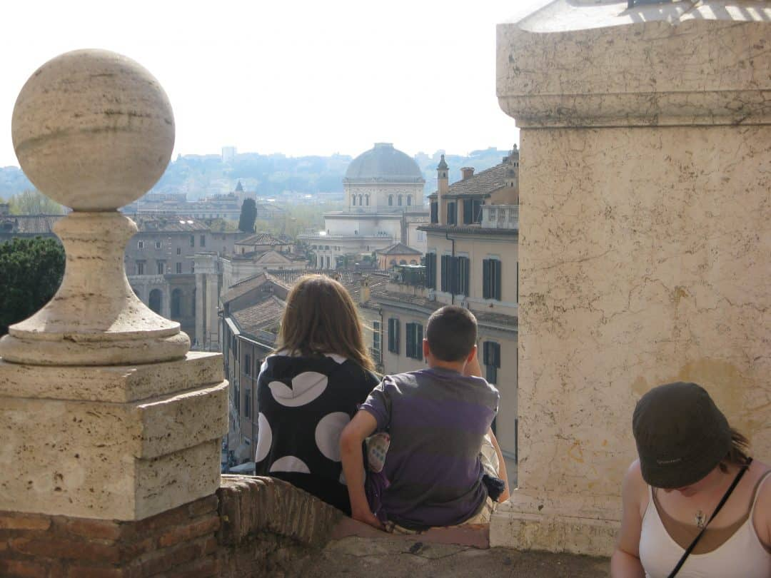 two kids exploring Rome on their luxury family trip, how to travel the world with your family