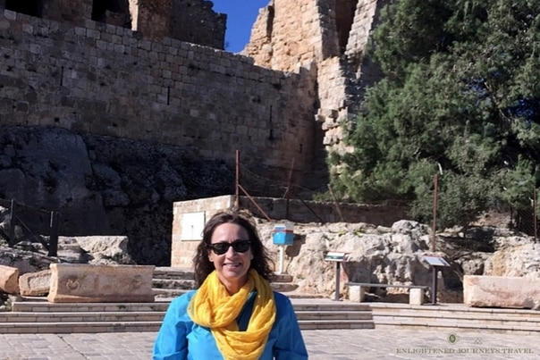 luxury travel advisor Theresa Jackson in front of one of the historic sites in Jordan, traveling in Jordan