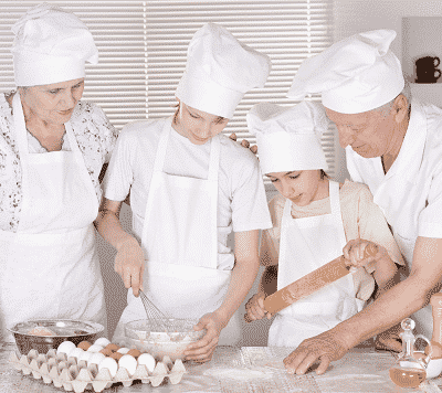 family takes a cooking class together on their multi familiy vacation