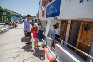 a family taking the train to start their luxury house rental, getting ready for her luxury sailing vacation