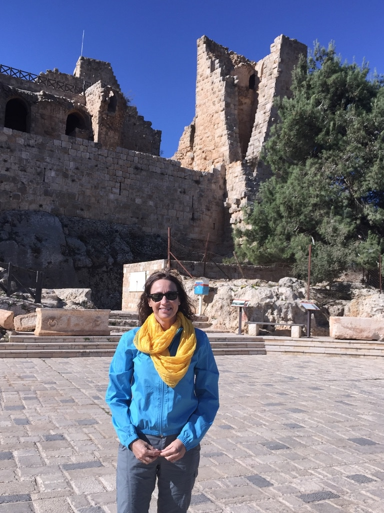luxury travel advisor Theresa Jackson in front of Jordan's historical treasures