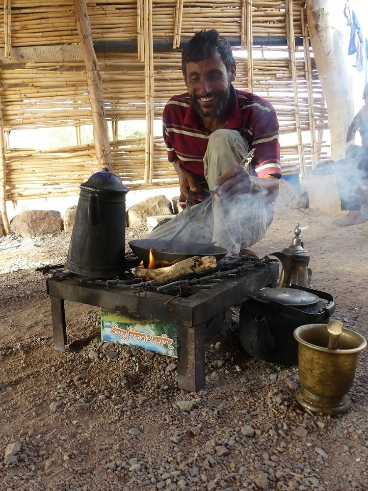 cooking on open fire underneath a tenth in a bedouin village in Jordan, visited by luxury travel advisor Theresa Jackson