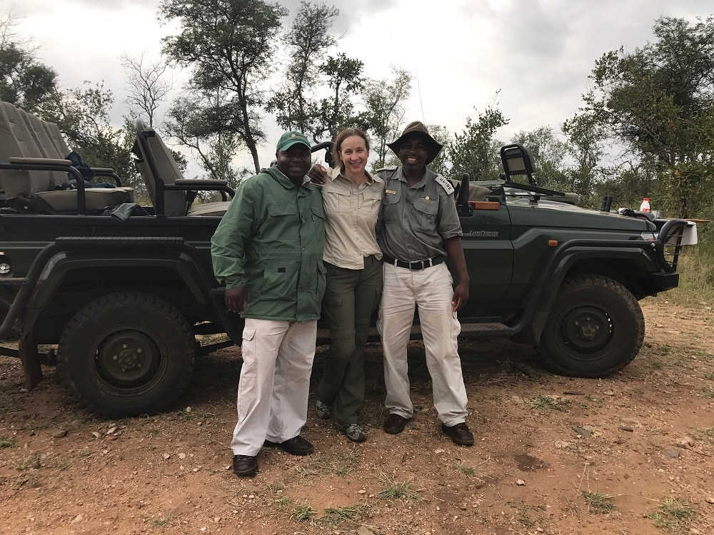 luxury travel advisor Theresa Jackson with national park rangers in the Kruger national park on her luxury eco safari tour