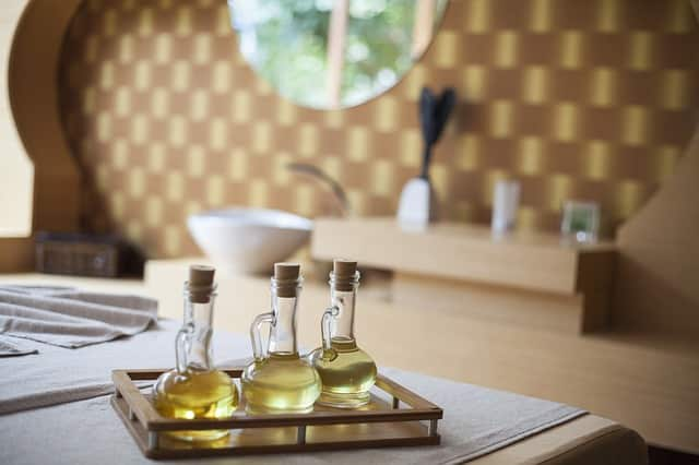 massage oils on a table in one of the luxury European spas, traveler on one of the most gorgeous European spa vacations