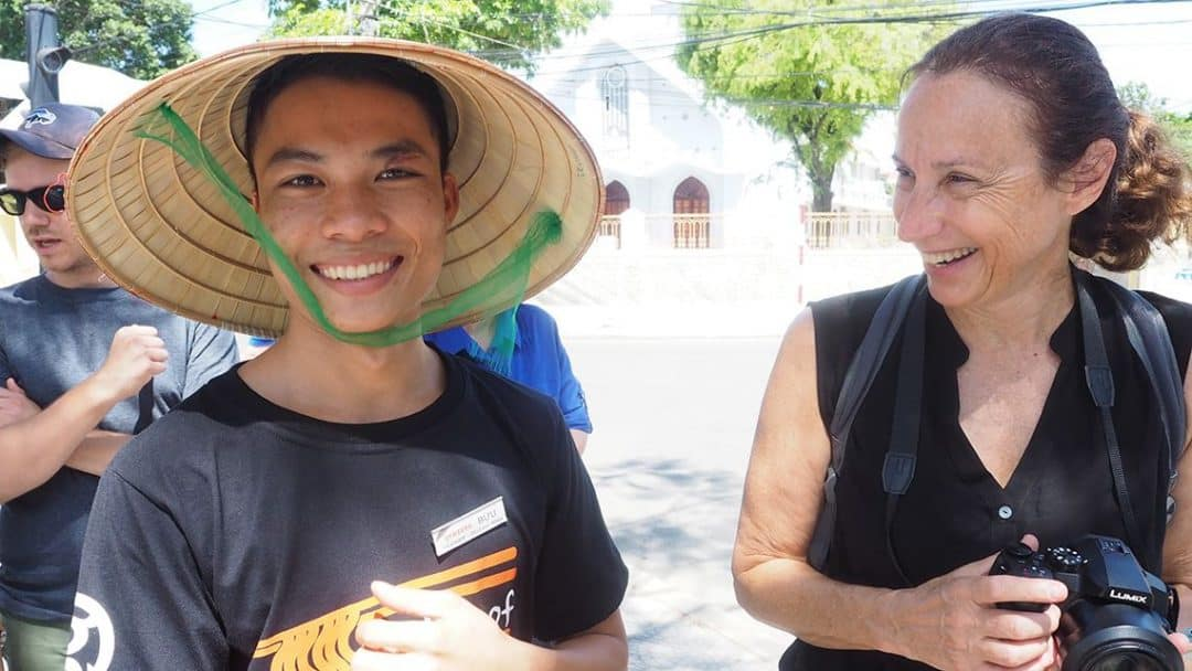 "luxury travel advisor Theresa Jackson with one of the outstanding students from the Planterra Foundation's ""Oodles of Noodles"" Project, helping students to have brighter futures through sustainable and life-changing Vietnam travel"