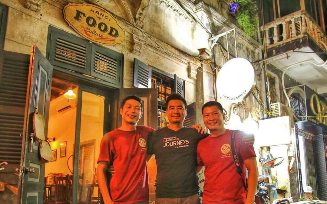 social entrepreneurs in front of their Hanoi Food Culture restaurant, Vietnam vacation, travel for good