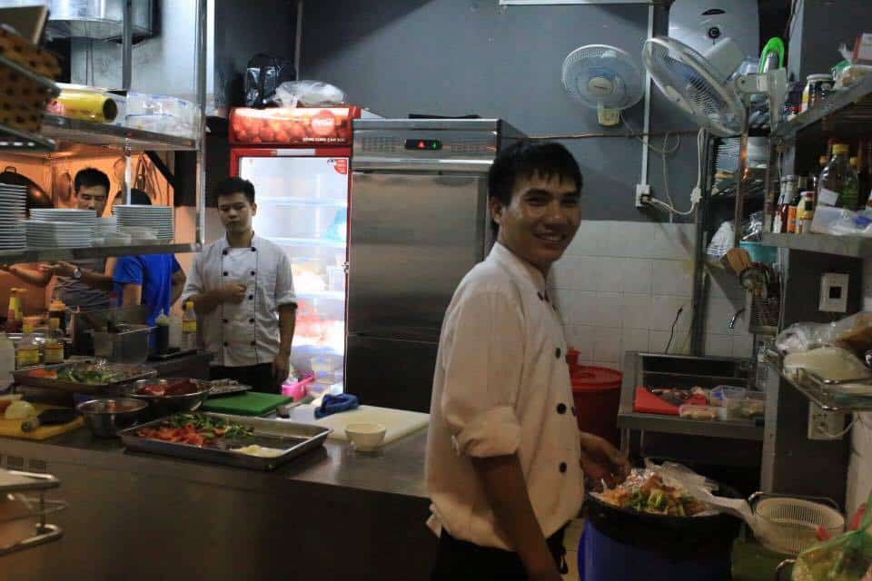 students in the kitchen of the Hanoi Food Culture restaurant, a social enterprise in Hanoi Vietnam