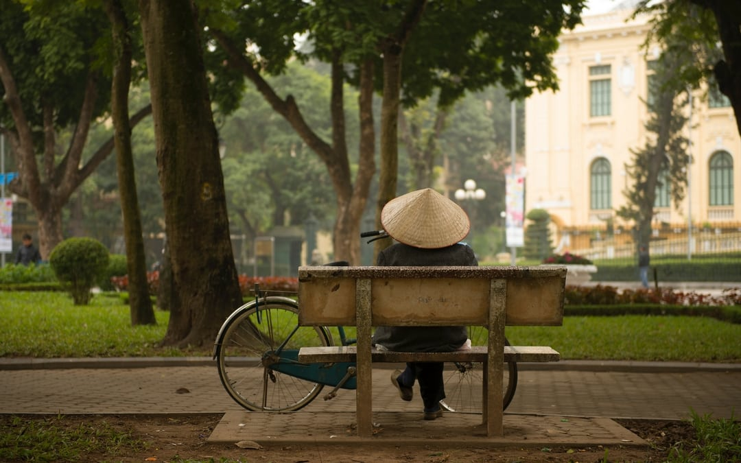 Vietnamese on a park bench in Hanoi, Vietnam, vietnam vacation travel for good, image source Lukasz Saczek 36808