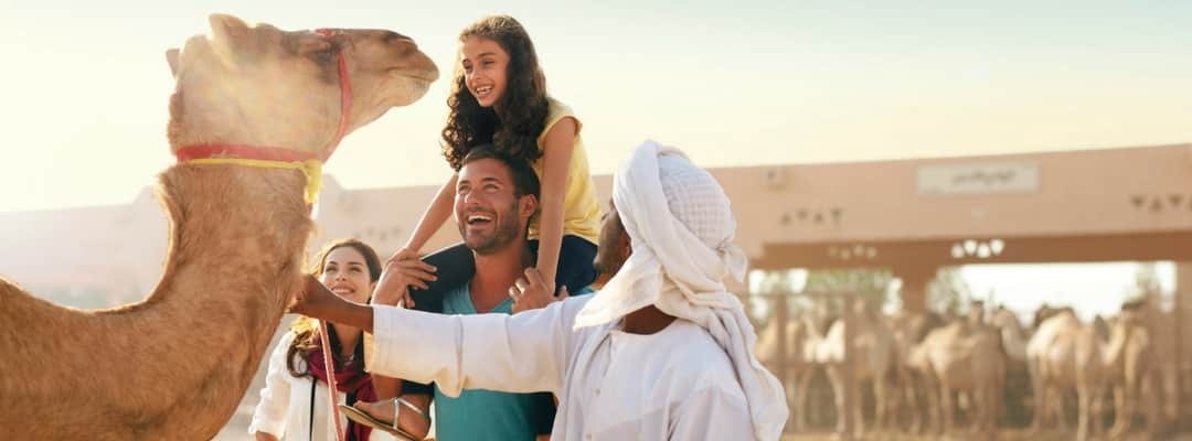 European family at the Abu Dhabi camel market, vacation in Abu Dhabi