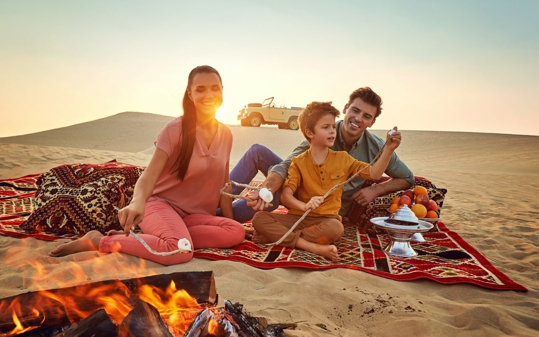 European family camping in the Abu Dhabi desert, vacation in Abu Dhabi