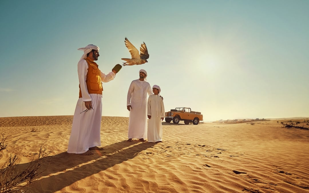 falconry Arabic family in the Abu Dhabi desert, vacation in Abu Dhabi