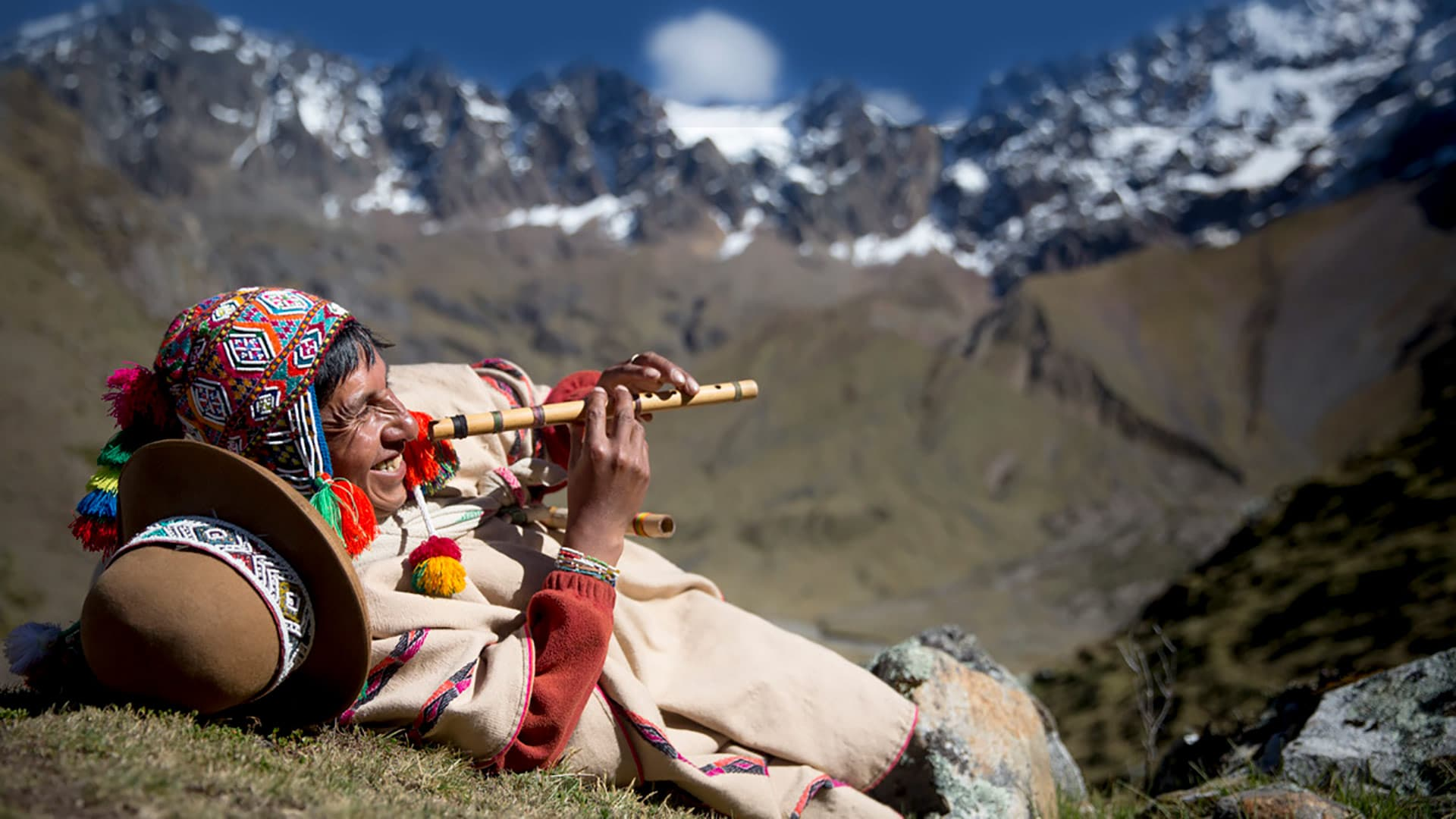 Peruvian flute player in Peru, luxury ecotourism is romantic