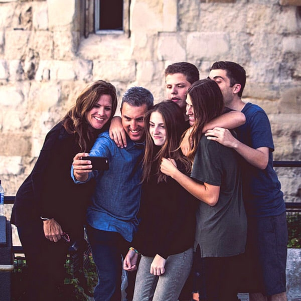 family taking a selfie on their luxury family travel vacation, luxury travel services provided by luxury travel advisor Theresa Jackson, Enlightened Journeys Travel