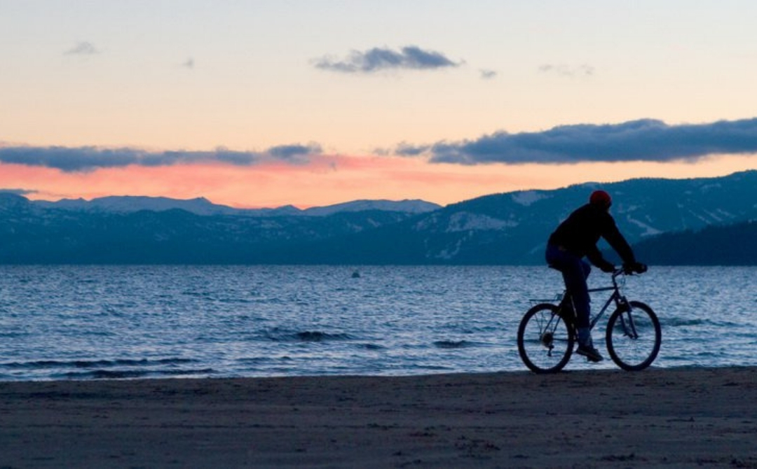 man cycling on the beach in Vietnam, Best Travel Destinations in Asia for Water, Adventure and Beach Lovers