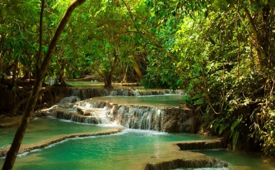beautiful blue-green river in Laos, Best Travel Destinations in Asia for Water, Adventure and Beach Lovers
