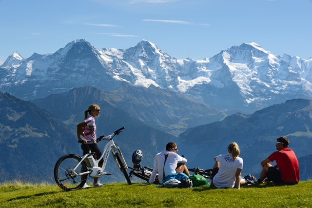 group journey: Bicycling Vacations in Switzerland: Ebiking from Alpine Valleys to Snow-Capped Peaks.