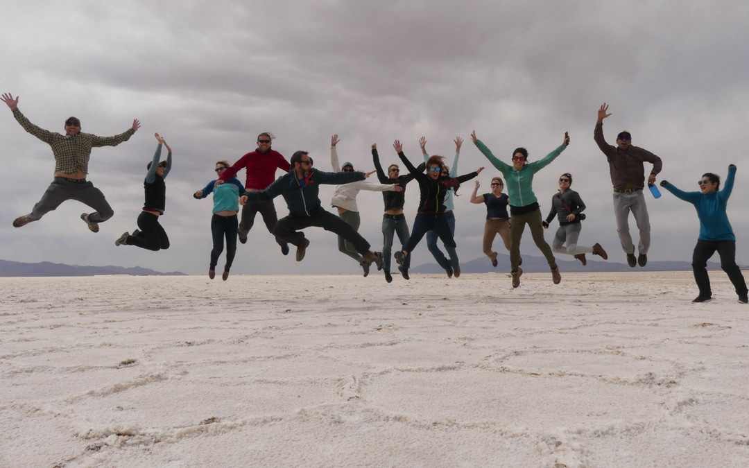 Luxury Travel Advisor Theresa Jackson and her travel group jumping up in the air at the Great Salt Flat Salinas