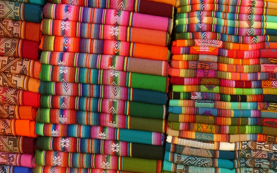 luxury travel advisor Theresa Jackson, founder of Enlightened Journeys Travel, I visit Purmamarca town; surrounded by all the natural beauty, the market square is ablaze in colors of woven textiles punctuated with silverware goods.