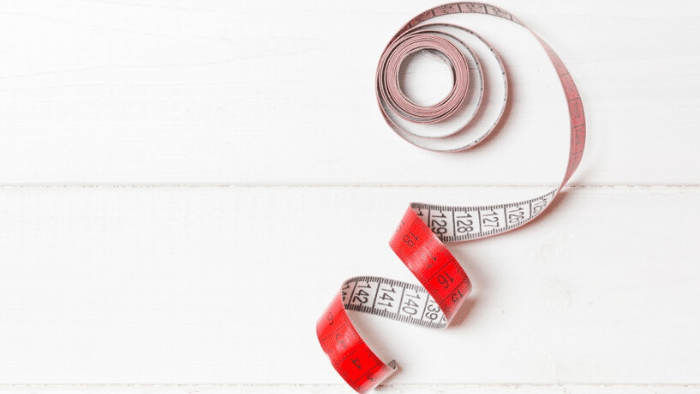 red and white measure tape